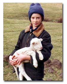 Teacher Lisa as a child with one of her lambs.
